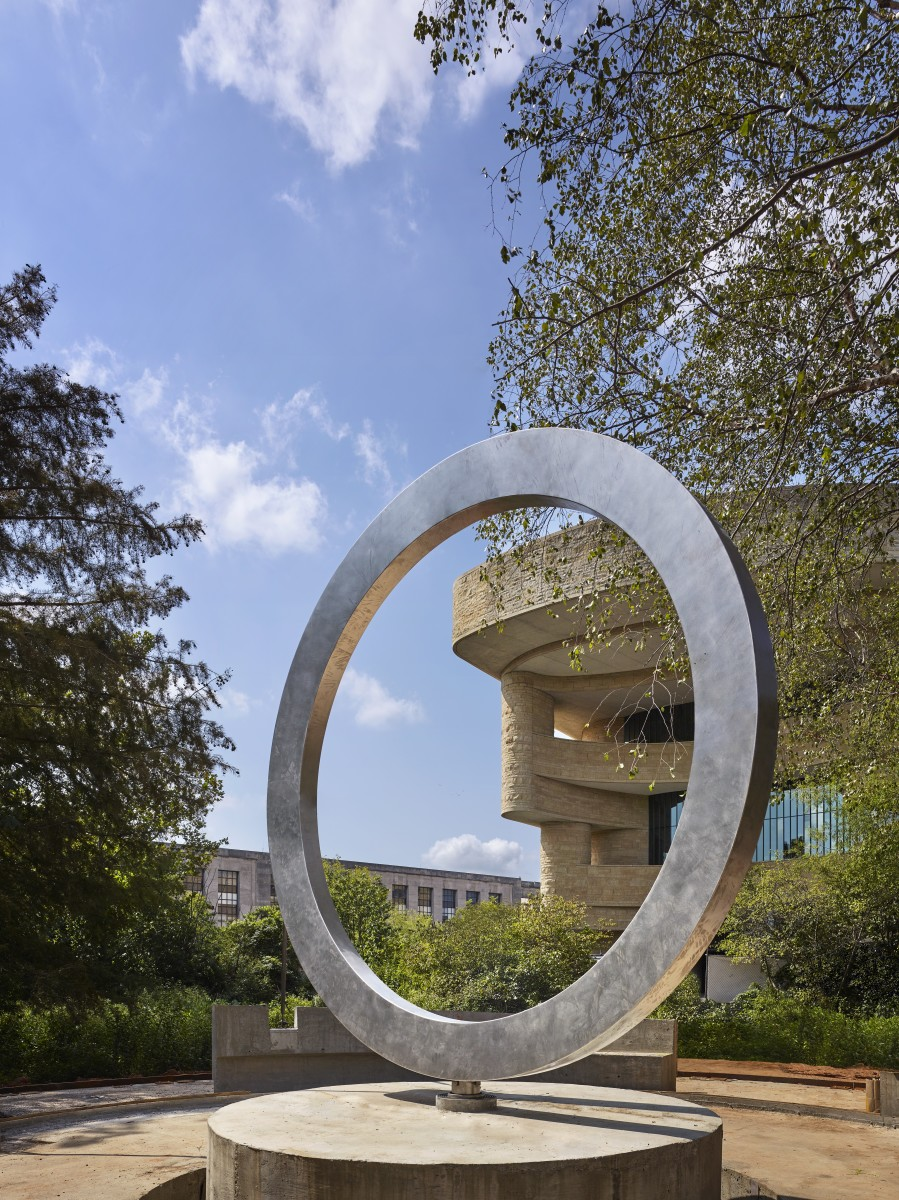 """The National Native American Veterans Memorial is a """"stainless steel circle resting on a carved stone drum"""" sitting just outside the museum. (Photo by Alan Karchmer for NMAI)"""