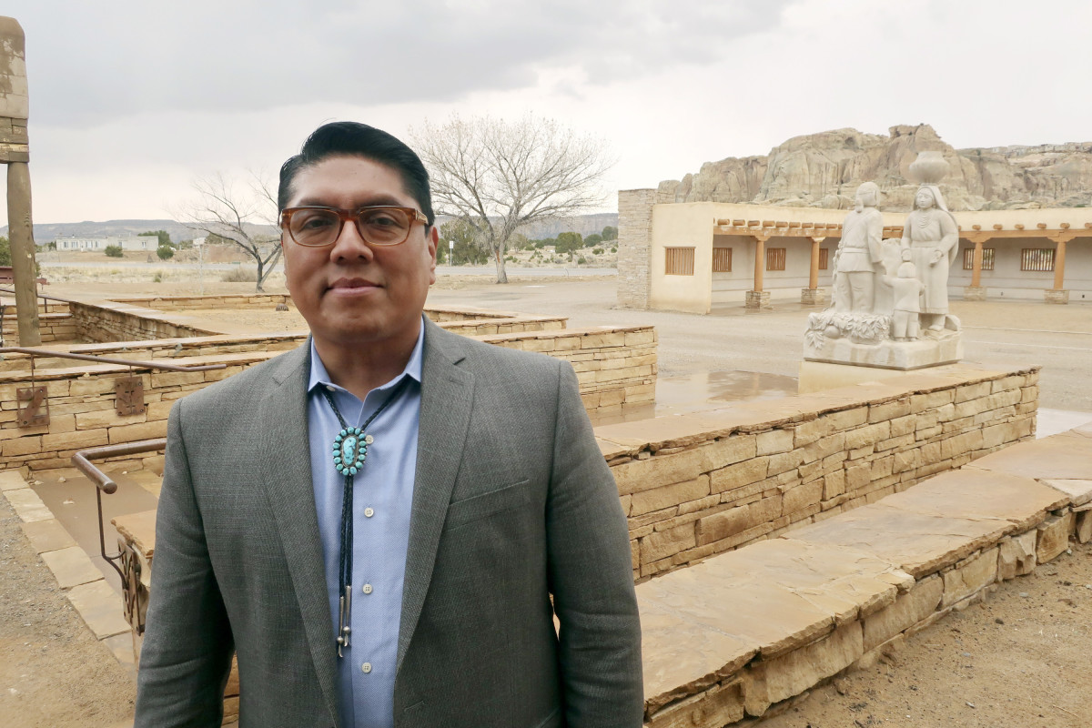 "In this March 21, 2019 file photo, Acoma Pueblo Gov. Brian Vallo poses outside the Pueblo's cultural center about 60 miles west of Albuquerque, New Mexico. A ceremonial shield at the center of a yearslong international debate over exporting of sacred Native American objects to foreign markets has returned to New Mexico. U.S. and Acoma Pueblo officials planned Monday, Nov. 18 to announce the shield's return from Paris, where it had been listed for bidding in 2016 before the EVE auction house took the rare step of halting its sale. ""It will be a day of high emotion and thanksgiving,"" Vallo said ahead of the shield's expected return to his tribe. (AP Photo/Felicia Fonseca, File)"