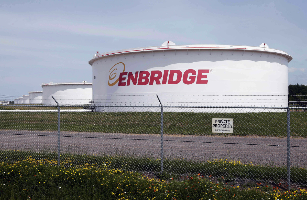 In this June 29, 2018 photo, tanks stand at the Enbridge Energy terminal in Superior, Wisconsin. Minnesota utility regulators reaffirmed their support Thursday, June 25, 2020, for Enbridge's plan to replace its aging Line 3 crude oil pipeline. The Minnesota Public Utilities Commission voted 4-1 to reject petitions for reconsideration filed by several Ojibwe bands, environmental groups and the state Commerce Department. (AP Photo/Jim Mone, File)