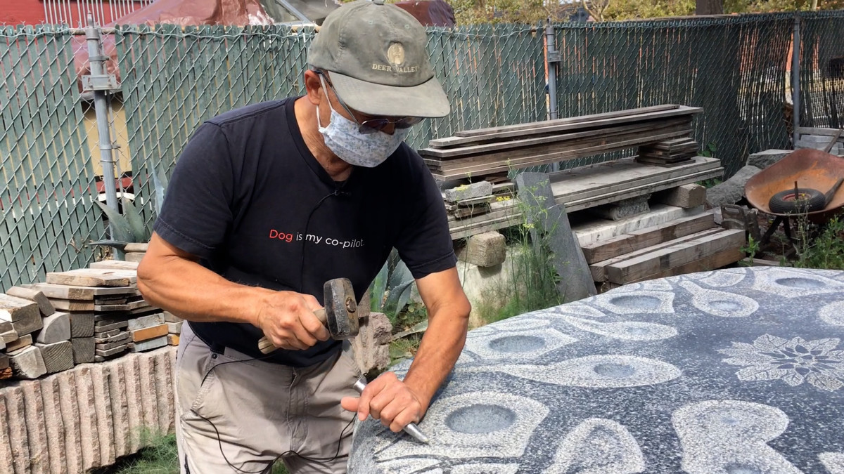 Sculptor Masayuki Nagase works on one of the pieces for his installation in the Richmond, California, shellmound park. His work draws on study of the Native culture and traditions of the area. (Photo by Tom Herriman)