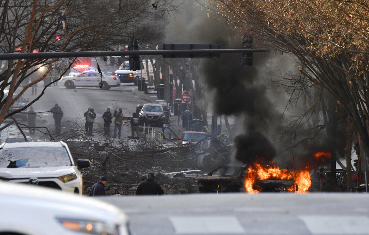 A vehicle is on fire after an explosion in the area of Second and Commerce Friday, Dec. 25, 2020 in Nashville, Tenn. Buildings shook in the immediate area and beyond after a loud boom was heard early Christmas morning. (Andrew Nelles/The Tennessean via AP)