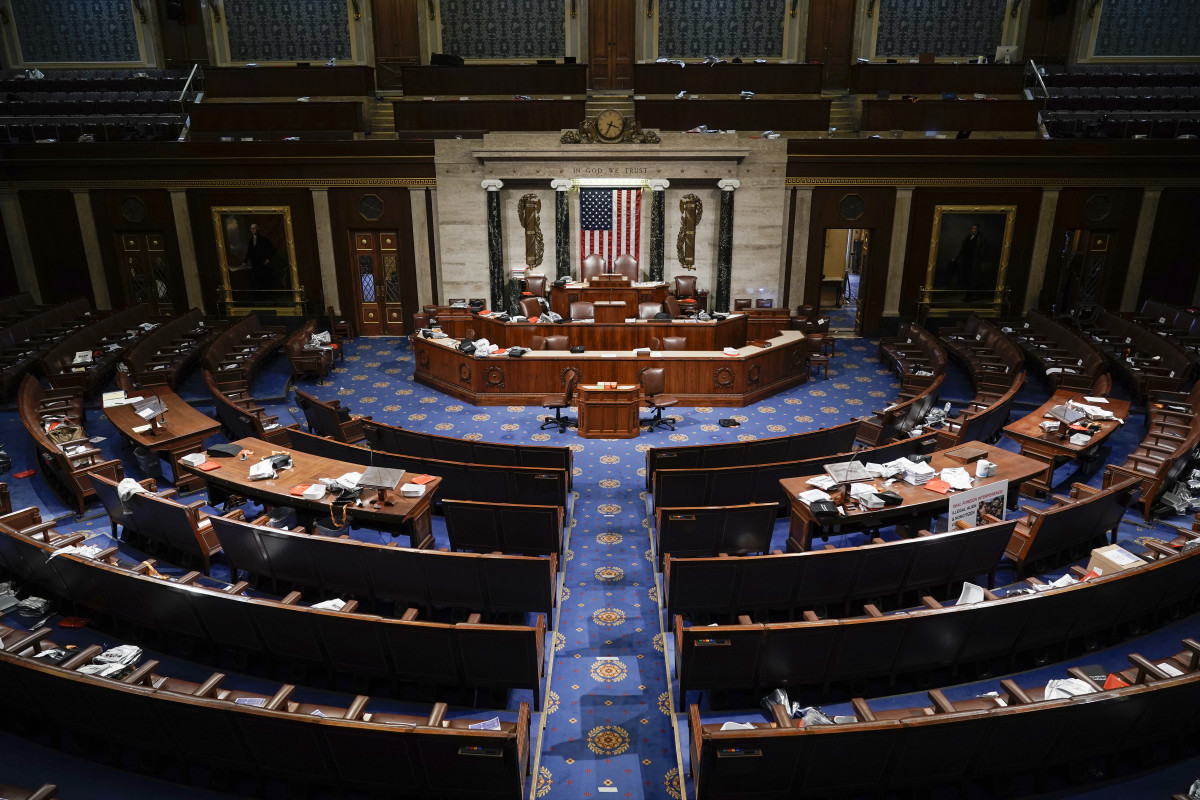The House Chamber is empty after a hasty evacuation as protesters tried to break into the chamber at the U.S. Capitol on Wednesday, Jan. 6, 2021, in Washington. (AP Photo/J. Scott Applewhite)