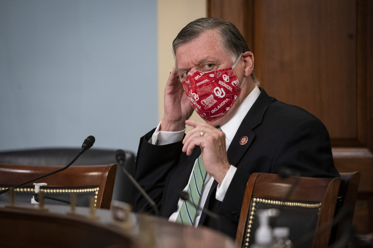 Rep. Tom Cole, R-Okla., puts on a face mask during a Labor, Health and Human Services, Education, and Related Agencies Appropriations Subcommittee hearing about the COVID-19 response on Capitol Hill in Washington, Thursday, June 4, 2020. (Al Drago/Pool via AP)