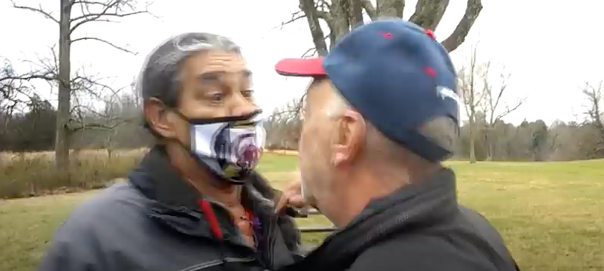 Philip Yenyo, executive director of the American Indian Movement of Ohio, tries to prevent members of the Pass the Salt Ministries from entering the grounds of the Serpent Mound. (Screen shot of YouTube video by Mary Annette Pember)