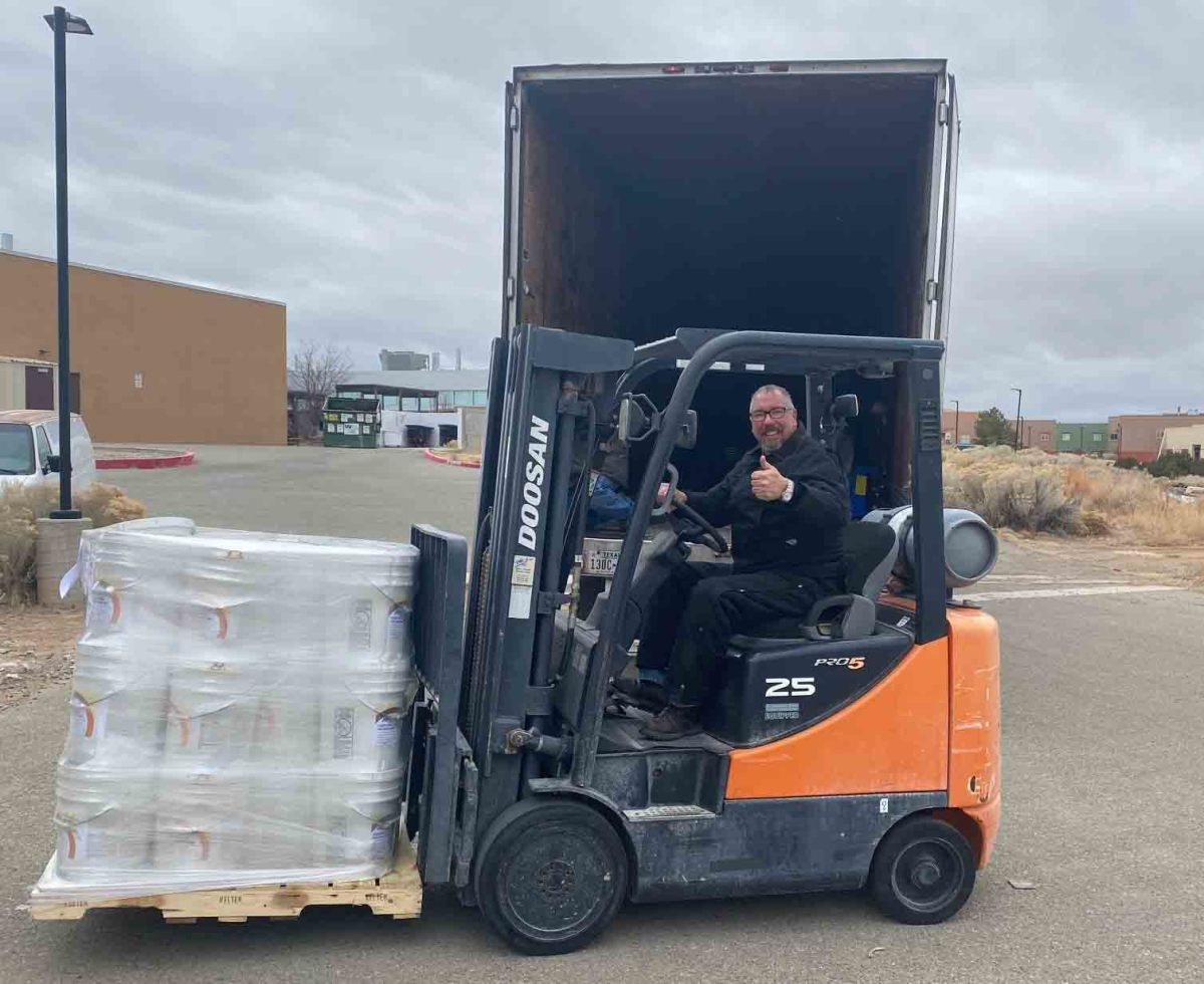 Peter Romero, director of facilities and security at the Institute of American Indian Arts in Santa Fe, New Mexico, readies the college's newly delivered supply. (Photo courtesy of Dina Horwedel)