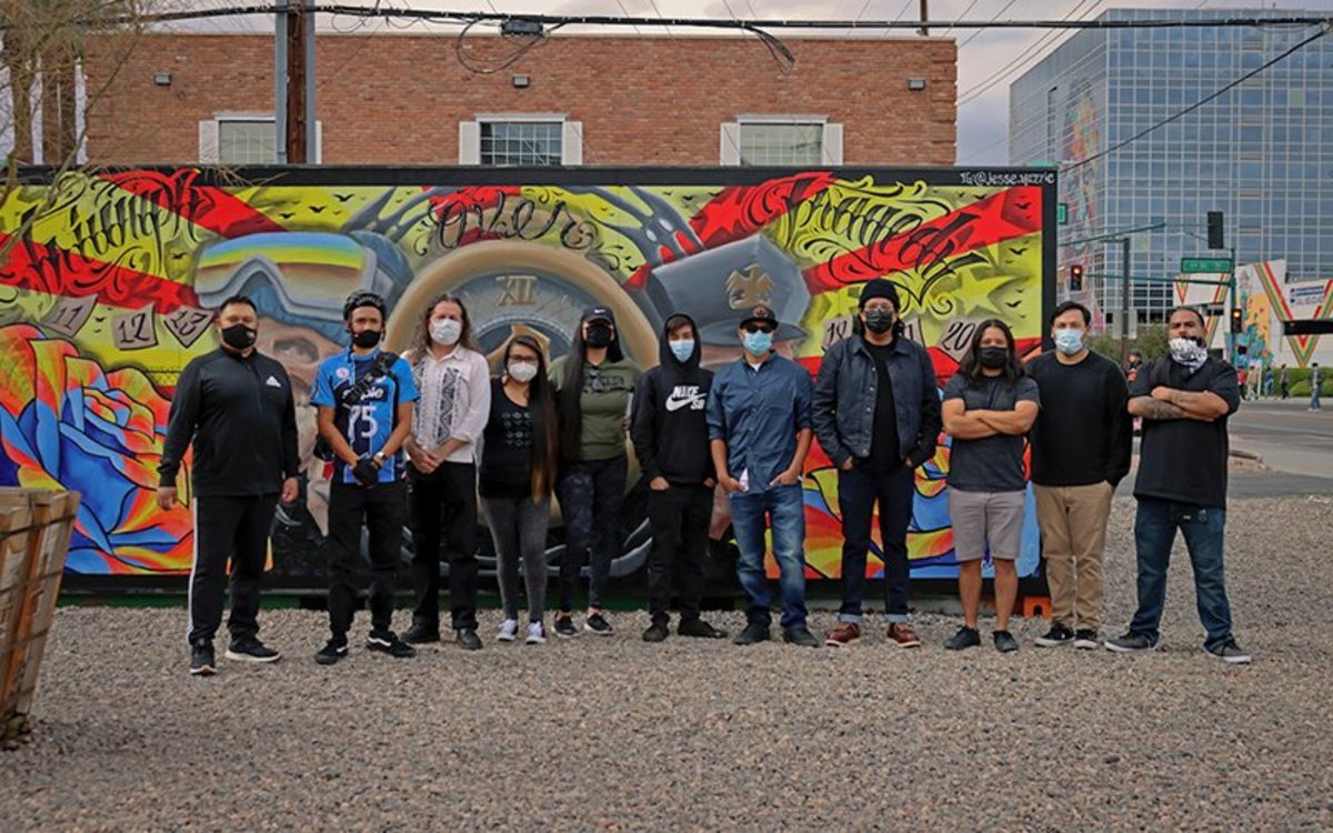 Artists and collaborators involved in UNCONTAINED, a quarterly art installation project in Roosevelt Row, include, from left, Rocky Tano, Jeremy Arviso, Oliverio Balcells, Eunique Yazzie, Melody Lewis, Jake Yazzie, Jesse Yazzie, Danny Upshaw, Brian Skeet, Paul Molina and Zachary Justin. (Photo courtesy of Roosevelt Row Community Development Corp.)