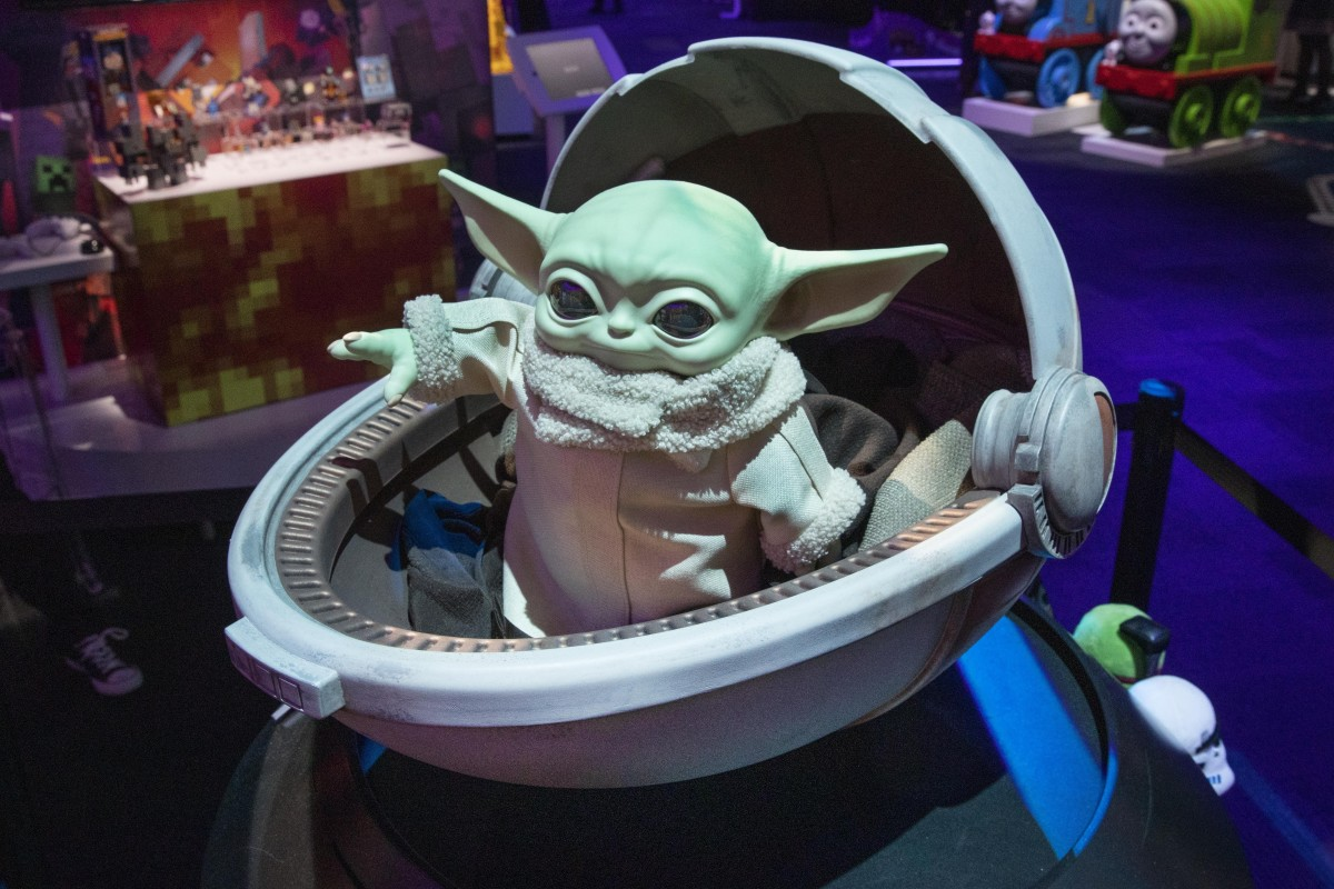 A Baby Yoda doll, by Mattel, is displayed at Toy Fair New York, in the Javits Convention Center, Monday, Feb. 24, 2020. From Baby Yoda to eco-friendly stacking rings, toymakers displayed an array of goods that they hope will be on kids' wish lists for the holiday 2020 season. The four-day Toy Fair comes as the U.S. toy industry has been whipsawed by a number of obstacles. (AP Photo/Richard Drew)