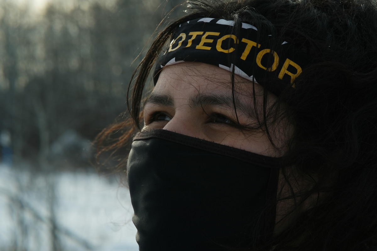 Taysha Martineau of the Fond du Lac tribe is a water protector and has helped build camp Migizi immediately next to one of the Enbridge Line 3 worksites on the Fond du Lac reservation on a piece of land she and others purchased. She and other water protectors stage actions from the camp and are working to learn traditional Ojibwe ways there. (Photo by Mary Annette Pember, Indian Country Today)