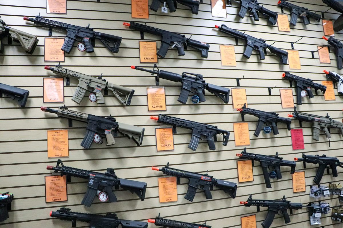 Airsoft long guns are displayed on a wall at VIP Airsoft Arena in Phoenix on Nov. 11. The guns look like real firearms but shoot nonlethal plastic pellets. (Photo by James Franks/Special for Cronkite News)
