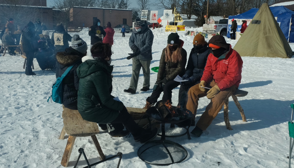 Water protectors hold an educational event on private property in Palisade, MN. The city of Palisade and Aitkin County banned them from using the public county park. (Photo by Mary Annette Pember)