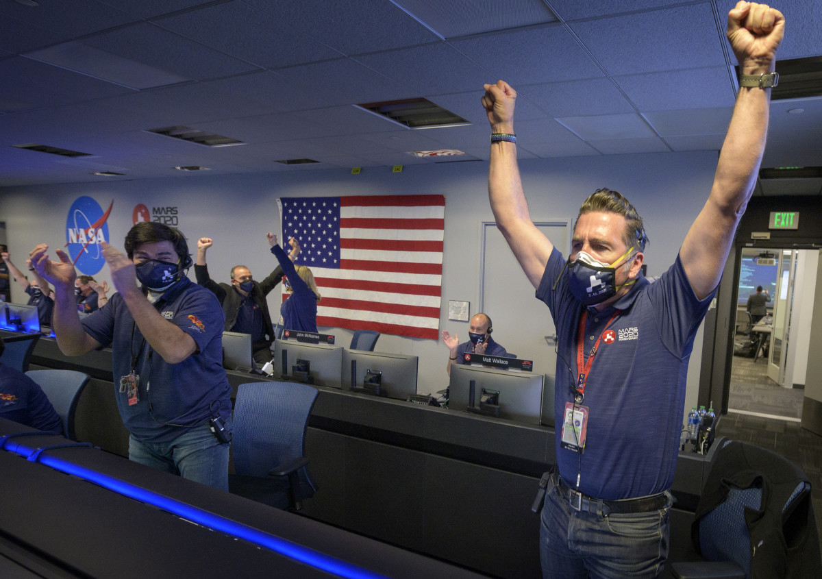 Members of NASA's Mars 2020 Perseverance rover mission celebrate on Feb. 18, 2021, after learning the spacecraft has touched down on Mars. They are in the Entry, Descent and Landing War Room at NASA's Jet Propulsion Laboratory in Southern California. (Photo courtesy of NASA/JPL-Caltech)