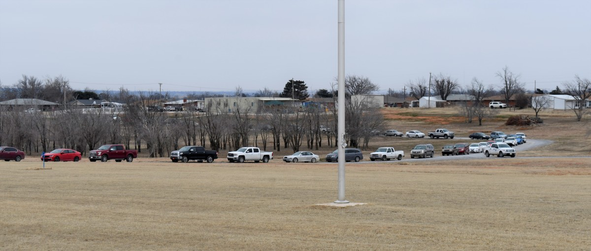 Cars line up for about four miles while people wait to receive boxes of food. (Photo by the Kiowa Tribe via Gaylord News)
