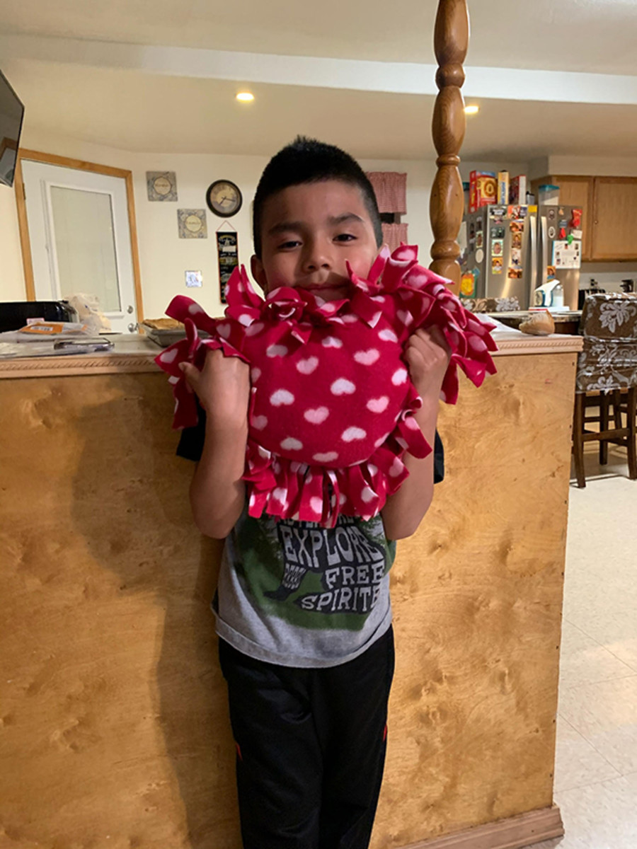 """Pictured: In the self-care kits, family-friendly activities included a """"make your own heart"""" pillow. Families took to social media to share their projects with the community."""