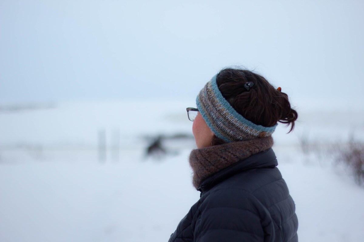 Resident, Lisa Ellanna, gazing towards the distant mountains in Nome. (Photo by Brisa Alarcon, KNOM).