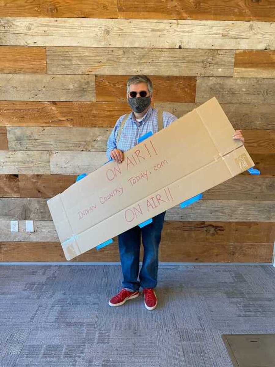 Indian Country Today Editor Mark Trahant with an ICT newscast sign at the Phoenix Indian School Visitor Center, March 5, 2021. (Photo by Indian Country Today)