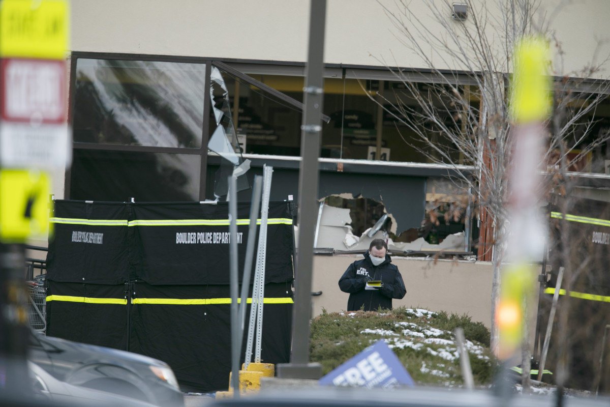 Police work on the scene outside of a King Soopers grocery store where authorities say multiple people were killed in a shooting, Monday, March 22, 2021, in Boulder, Colo.. (AP Photo/Joe Mahoney)