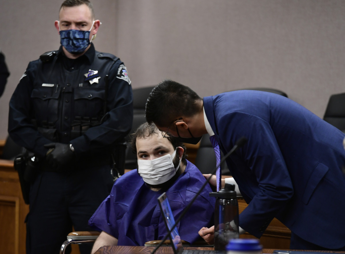 "Ahmad Al Aliwi Alissa, 21, appears before Boulder District Court Judge Thomas Mulvahill at the Boulder County Justice Center in Boulder, Colo. on Thursday, March 25, 2021. Three days after he was led away in handcuffs from a Boulder supermarket where 10 people were fatally shot, Alissa appeared in court for the first time and his defense lawyer asked for a mental health assessment ""to address his mental illness."" (Helen H. Richardson/The Denver Post via AP, Pool)"