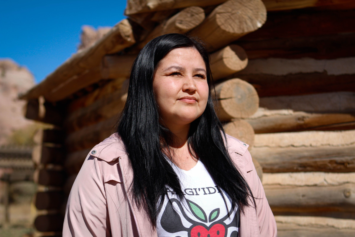 """Midwife and doula trainer Melissa Brown poses for a photo in Window Rock on Thursday, Oct. 24, 2019. Brown, part Navajo and Anishinaabe, had a traumatic experience when she first gave birth as a teen. """"I didn't understand how my body worked … how labor and delivery worked. I was very scared, and I didn't have much support."""" An Indigenous midwife helped with her second birth. """"It made all the difference. … I felt like I was able to be the mother that I wanted to be."""" She now trains doulas to help Indigenous women in the United States and Canada. (Photo by Delia Johnson/Cronkite News)"""
