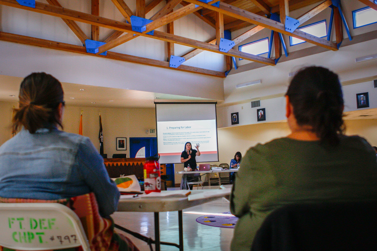 Midwife and doula trainer Melissa Brown explains what to expect during pregnancy and labor at a workshop in Window Rock, Arizona, on Friday, Oct. 25, 2019. She trains indigenous women to be midwives and doulas across the United States and Canada. (Photo by Delia Johnson/Cronkite News)