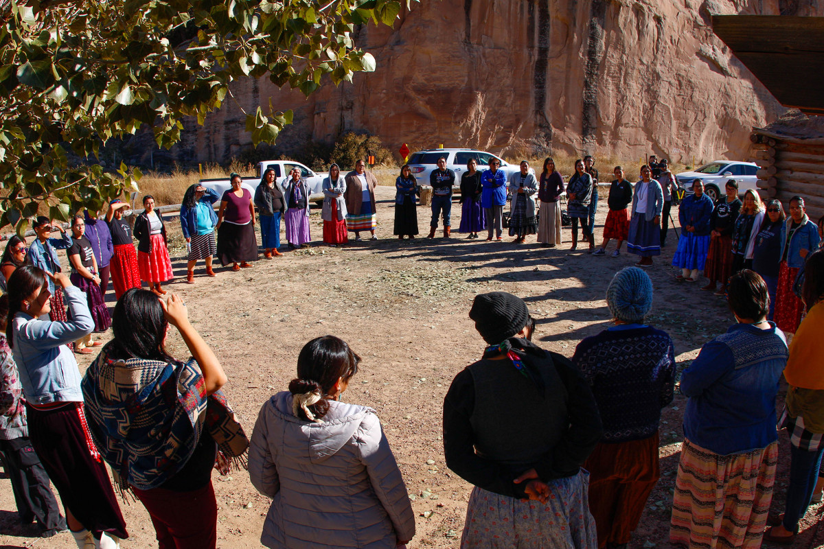 Participants gather at the end of the day at an Indigenous doula workshop in Window Rock, Arizona, on Thursday, Oct. 24, 2019. One by one, the women shared a word to reflect how they felt: Happy. Safe. Joyful. Supported. Sovereign. Brave. (Photo by Delia Johnson/Cronkite News)