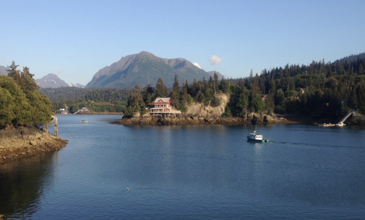 Boat, waterfront home, private dock, water mountains, sky, Halibut Cove, Alaska