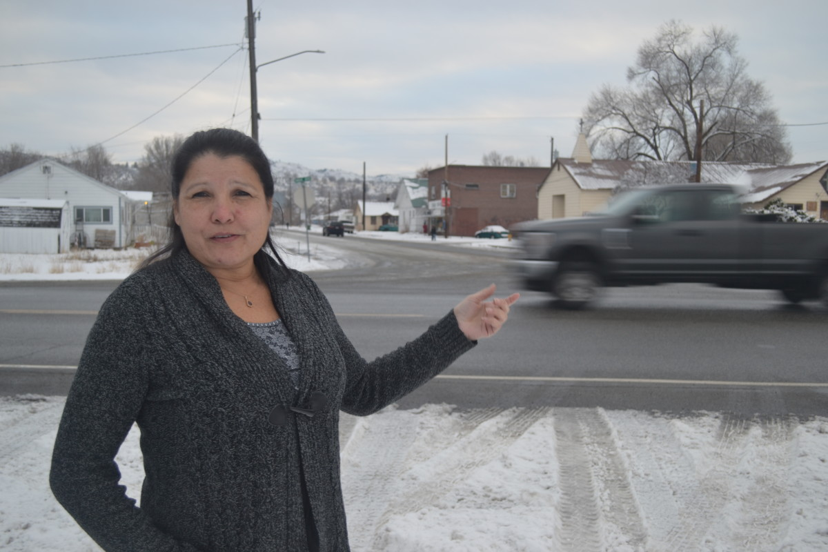 Norma Sanchez, a Colville Tribal Council member, points out where she says in 2017 she saw three state troopers stopping cars near where tribal land overlaps with the city of Omak in north central Washington. InvestigateWest's analysis found nearly one-third of all high-discretion searches of Native Americans by the Washington State Patrol happened where U.S. 97 entered the Colville and Yakama reservations. (Photo courtesy of InvestigateWest)