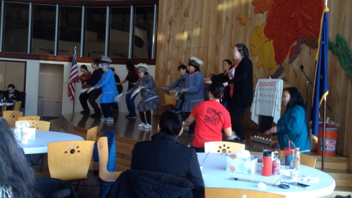 People joined the Yup'ik Acilquq Dance Group as it performed while the audience had lunch.