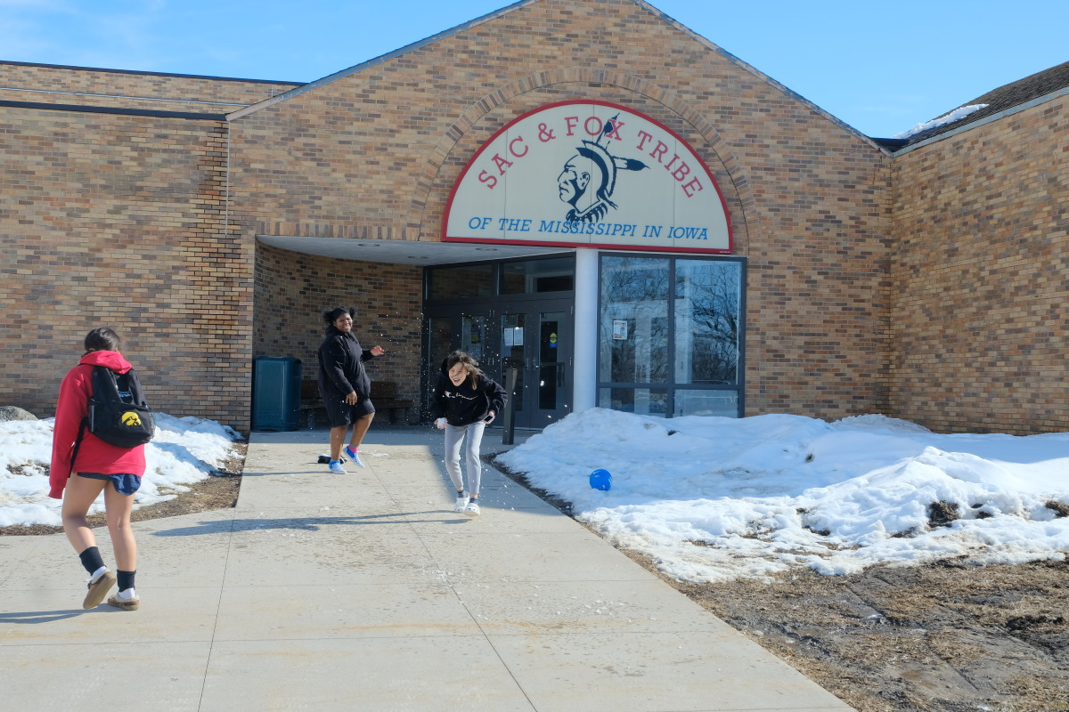 The Meskwaki Lady Warriors volleyball finished their practice with a snowball fight in front of the Meskwaki Nation tribal center. The Democratic caucus takes place in the building Feb. 3 at 7 p.m. CST. (Photo by Mary Annette Pember)
