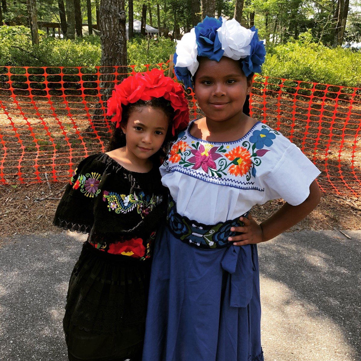 Fressia Jones (right) wore her regalia, which was gifted by her maternal grandmother Alba, for the first time and attended the 98th annual Mashpee Wampanoag Pow Wow, along with her cousin Mattisse Montes (left), in July of 2019. (Photo courtesy Rachael Devaney)