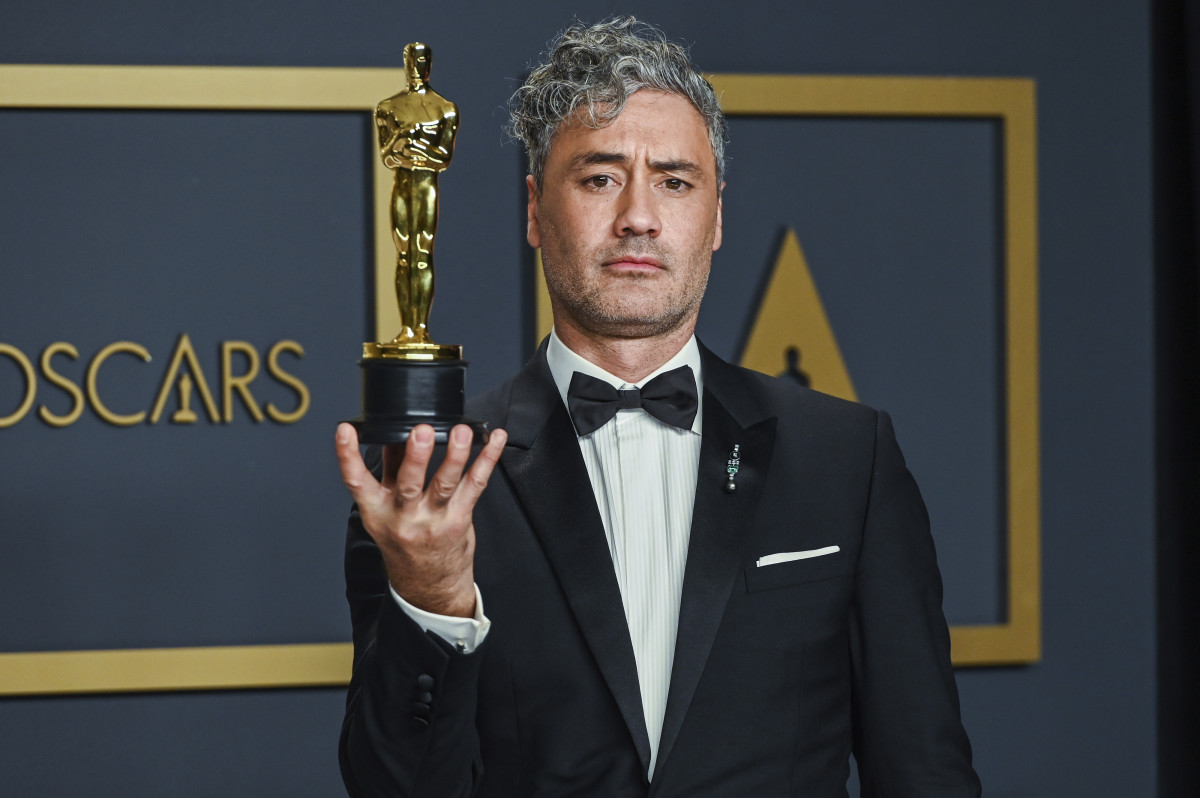 Taika Waititi posing in the press room at the 92nd Annual Academy Awards held at the Dolby Theatre in Hollywood, California on Feb. 9, 2020. He is shown holding the Emmy he won for Best Adapted Screenplay for the film Jojo Rabbit.