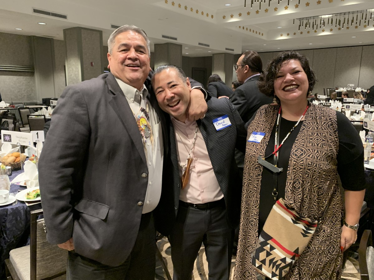 (L to R) Greg Abrahamson, David Bean from Puyallup, and Anna Bean from Puyallup. (Photo by Jourdan Bennett-Begaye)
