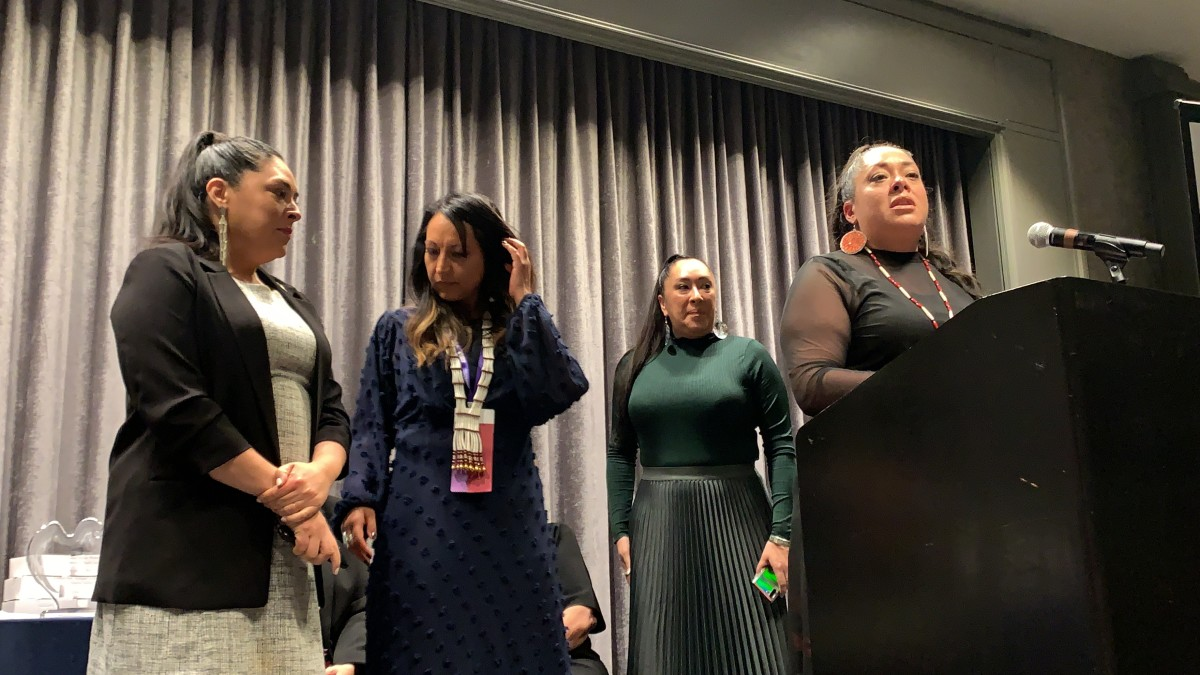 """Abigail Echo-Hawk, Pawnee, with her three sisters on stage at the 25th National Indian Women's """"Supporting Each Other"""" Honoring Lunch in Washington, D.C. (Photo by Jourdan Bennett-Begaye)"""