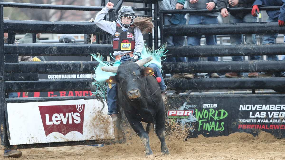 Najiah Knight riding a bull in a competition. (Photo courtesy IMG )