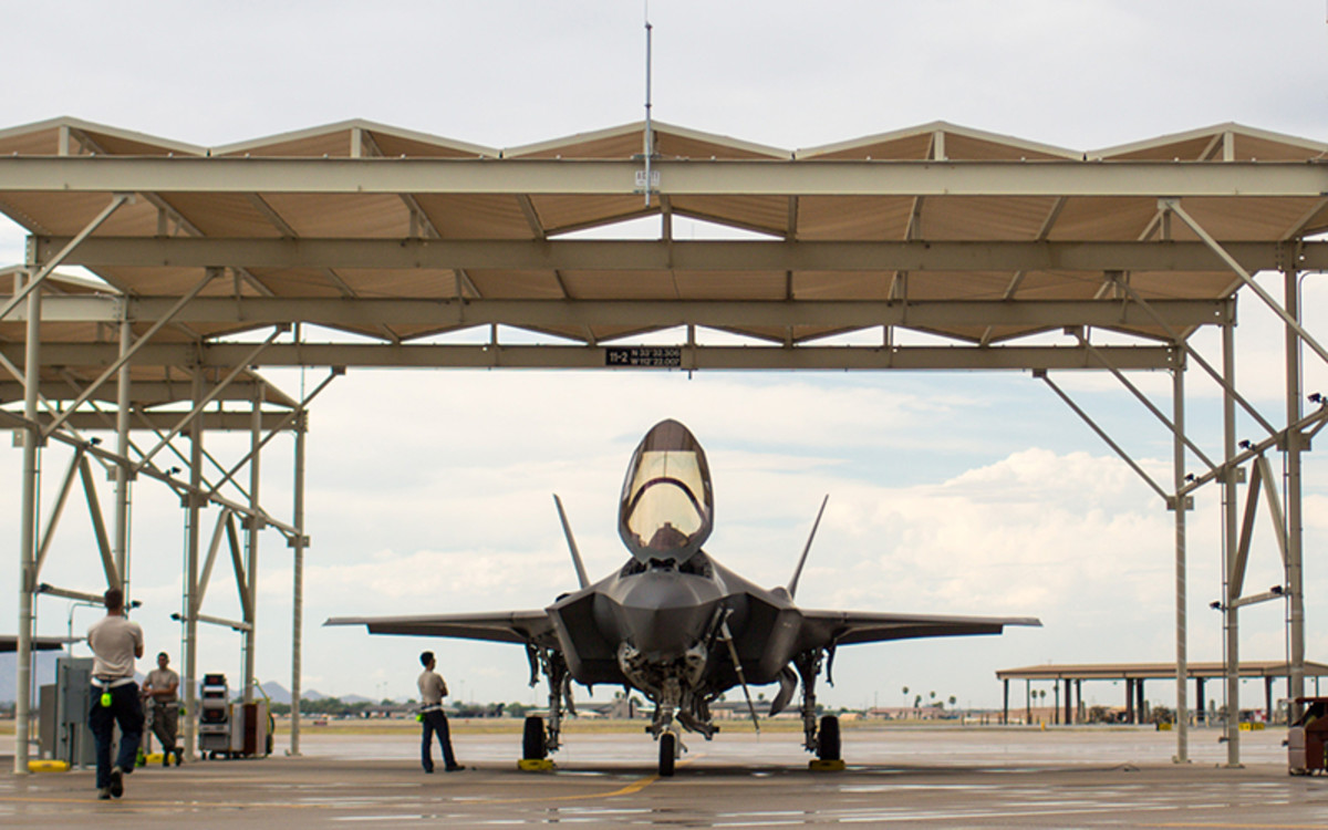 Ground crews check an F-35 at Luke Air Force Base in this December 2018 photo. A Pentagon plan to redirect $3.8 billion in fiscal 2020 funds to border wall construction would include funds allocated for two F-35s, to cargo jets, two V-22 Ospreys, money for the National Guard and more. (Photo by Nicole Neri/Cronkite News)
