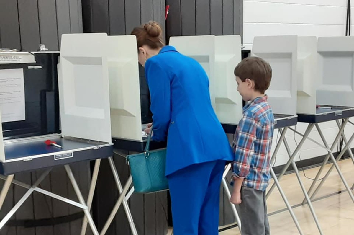 Tricia Zunker's nine year old son watches her vote in Wisconsin's special congressional election, where she is running for Congress. (Photo by Tricia Zunker for Wisconsin.)
