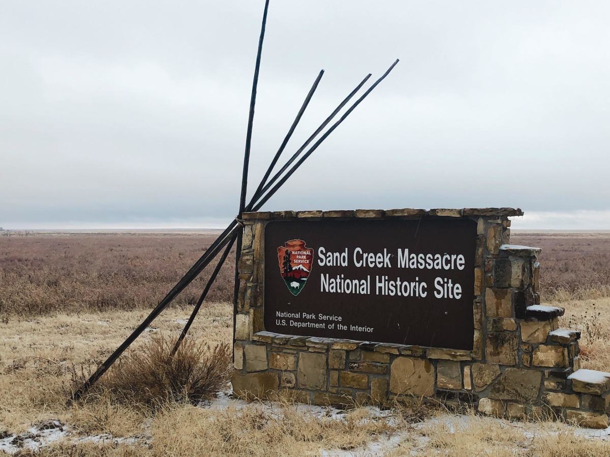 In this Dec. 27, 2019, photo, an entrance sign is shown at the Sand Creek Massacre National Historic Site in Eads, Colo. This quiet piece of land tucked away in rural southeastern Colorado seeks to honor the 230 peaceful Cheyenne and Arapaho tribe members who were slaughtered by the U.S. Army in 1864. It was one of worst mass murders in U.S. history. (AP Photo/Russell Contreras)