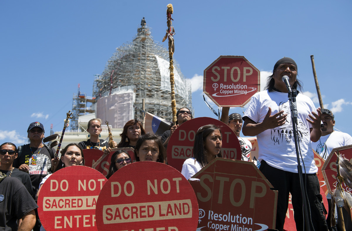 File photo: Wendsler Nosie, Sr. speaks with Apache activists in a rally to save Oak Flat, land near Superior, Ariz., sacred to Western Apache tribes, in front of the U.S. Capitol in Washington, Tuesday, July 22, 2015. The land sits on top of a large copper deposit and Resolution Copper Mine enlisted the help of Sen. John McCain. McCain, R-Arz., who attached a provision into a defense bill in December 2014 that transferred 2,400 acres of federal land to them in exchange for 5,300 acres of land owned by the company. McCain heralded the bill as a compromise that protects 800 acres of sacred land along Apache Leap, allows access to Oak Flats campgrounds and requires the mine to undergo an Environmental Impact Statement before it receives the land. (AP Photo/Molly Riley)