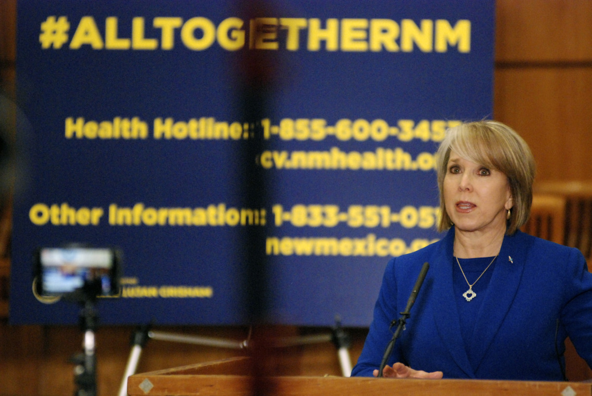 File: New Mexico Gov. Michelle Lujan Grisham on March 18, 2020, during a news conference about the coronavirus pandemic on the floor of the state House of Representatives in Santa Fe, N.M. (AP Photo/Morgan Lee)
