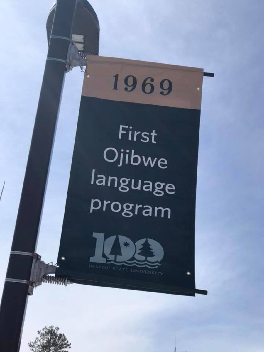 Collegiately in the world!!! This banner hangs in centennial plaza on campus. #ojibwemowin (Bemidji State University American Indian Resource Center, Facebook)