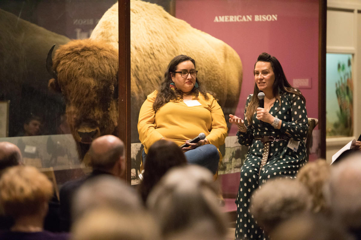 Curator Nina Sanders, right, and co-curator Meranda Roberts, left, speak at a donor event at the Field Museum on March 9, 2020. The event commemorated the largest  Indigenous-curated exhibit ever launched by the museum. (Photo by Trevor Reid)