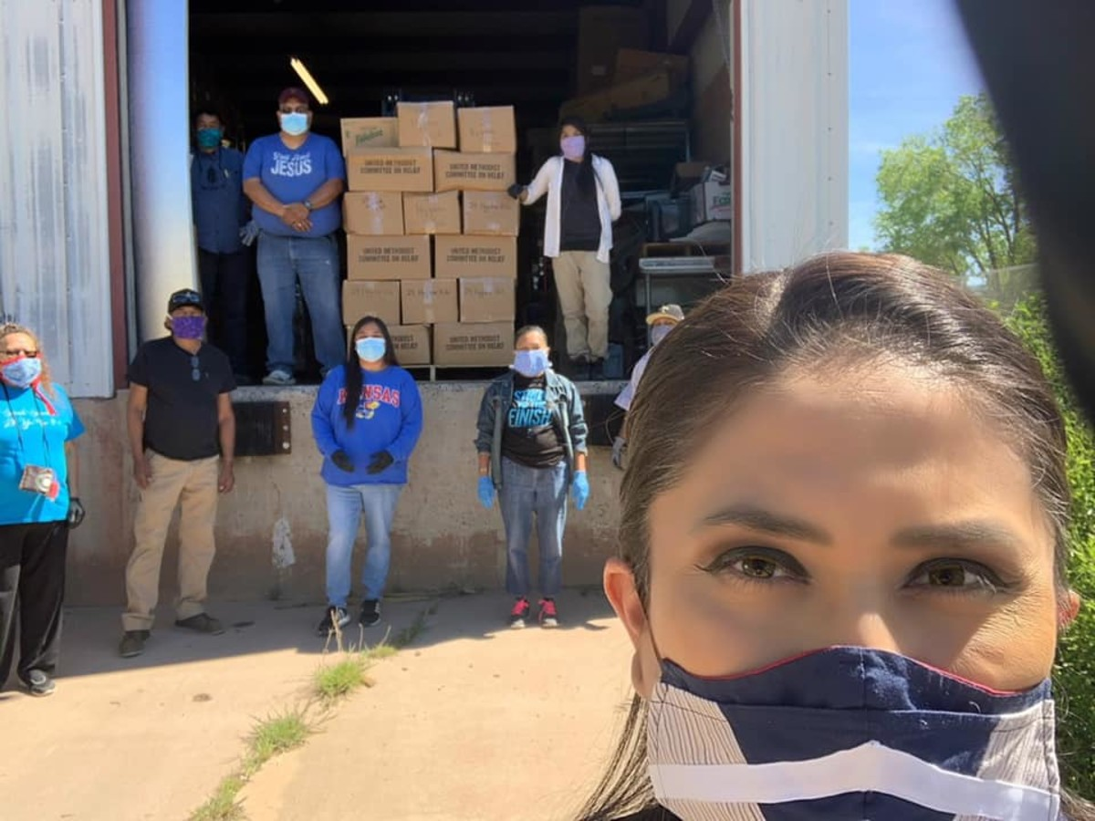"May 7, 2020: ""Food distribution helped me unload some kits there - these guys work hard!!!"" (Photo by White Mountain Apache Chairwoman Gwendena Lee-Gatewood, Facebook)"