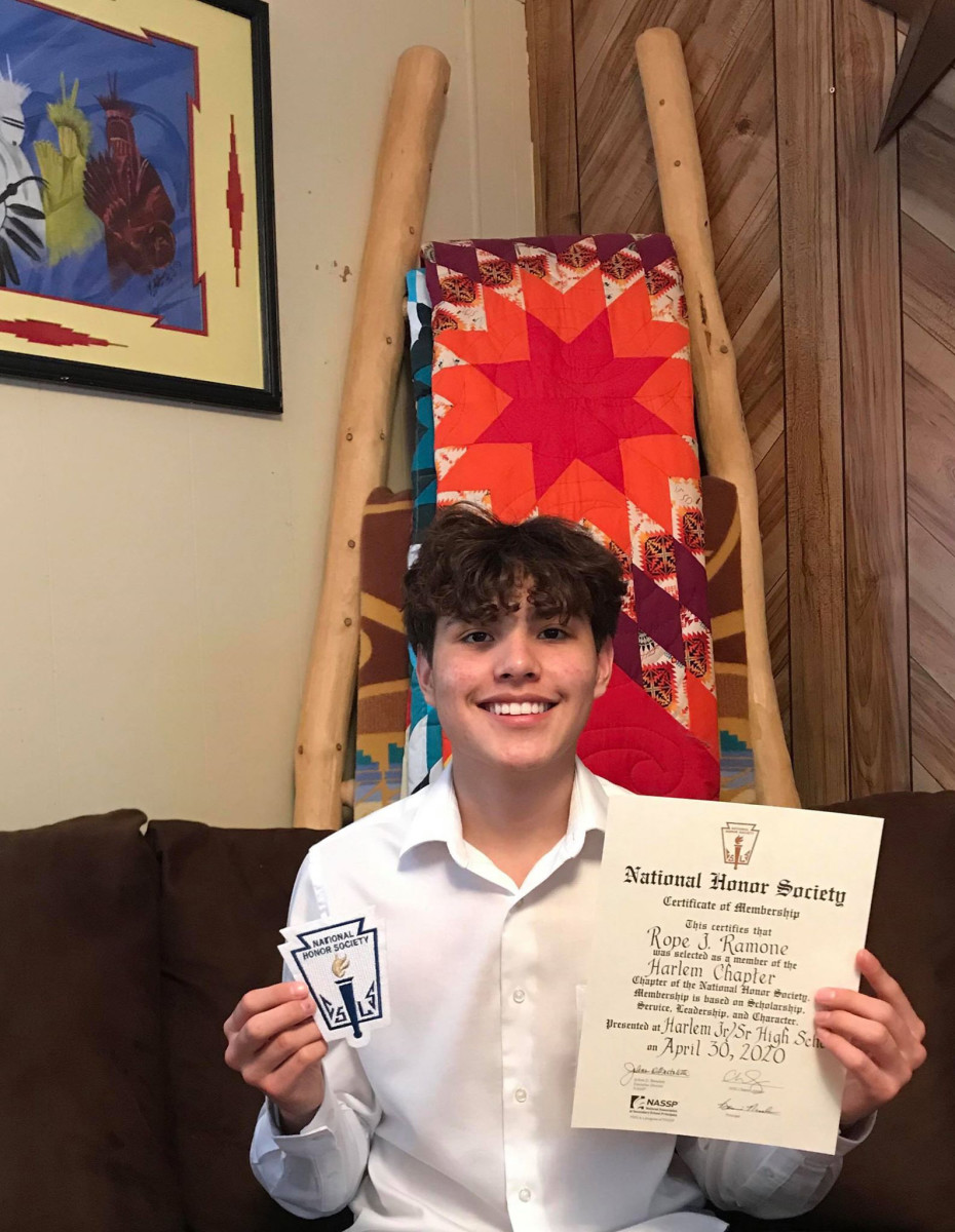 Toma Campbell's son, RJ Ramone, with his National Honors Society induction certificate. RJ is a student athlete and has a 4.0 GPA, despite not having in-home internet. He has faced unique challenges as COVID-19 forced schools to move to remote instruction – handwriting essays, picking up homework packets, and communicating with teachers via cell phone only. Contributed photo/Toma Campbell