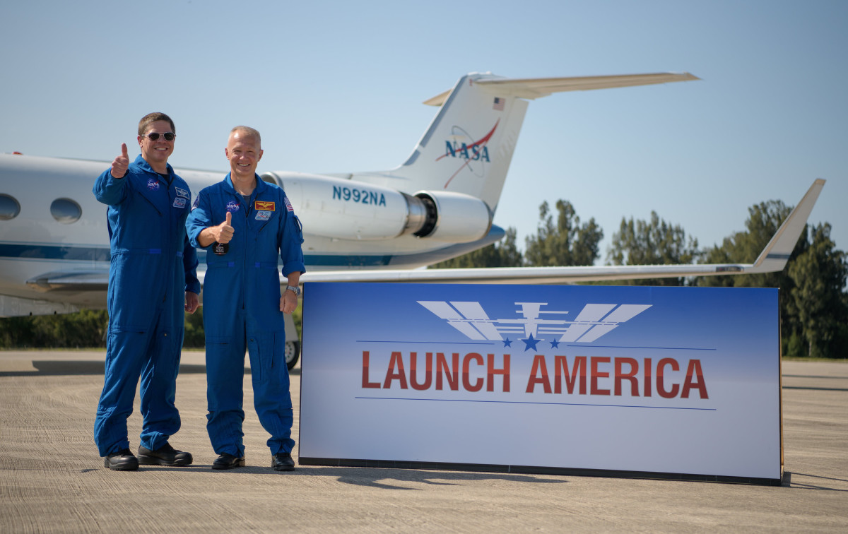NASA astronauts Robert Behnken, left, and Douglas Hurley gives a thumbs up after arriving at the Launch and Landing Facility at NASA's Kennedy Space Center ahead of SpaceX's Demo-2 mission, Wednesday, May 20, 2020, in Florida. NASA's SpaceX Demo-2 mission is the first launch with astronauts of the SpaceX Crew Dragon spacecraft and Falcon 9 rocket to the International Space Station as part of the agency's Commercial Crew Program. The flight test will serve as an end-to-end demonstration of SpaceX's crew transportation system. Behnken and Hurley are scheduled to launch at 4:33 p.m. EDT on Wednesday, May 27, from Launch Complex 39A at the Kennedy Space Center. A new era of human spaceflight is set to begin as American astronauts once again launch on an American rocket from American soil to low-Earth orbit for the first time since the conclusion of the Space Shuttle Program in 2011. (Photo by Bill Ingalls, NASA)