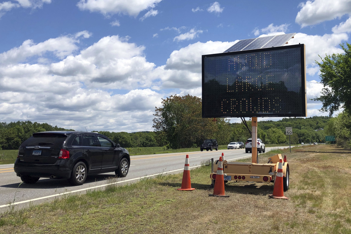 """Drivers on Connecticut Route 2, in Preston, Conn., Monday, June 1, 2020, pass one of four electronic signs erected Sunday night by the state to warn patrons of Foxwoods Resort Casino and Mohegan Sun about the potential dangers of being a large crowd and urging them not to """"gamble with COVID."""" Both tribal casinos, closed since March 17, opened despite opposition from Connecticut Gov. Ned Lamont, who has limited power regarding the sovereign nations. (AP Photo/Susan Haigh)"""