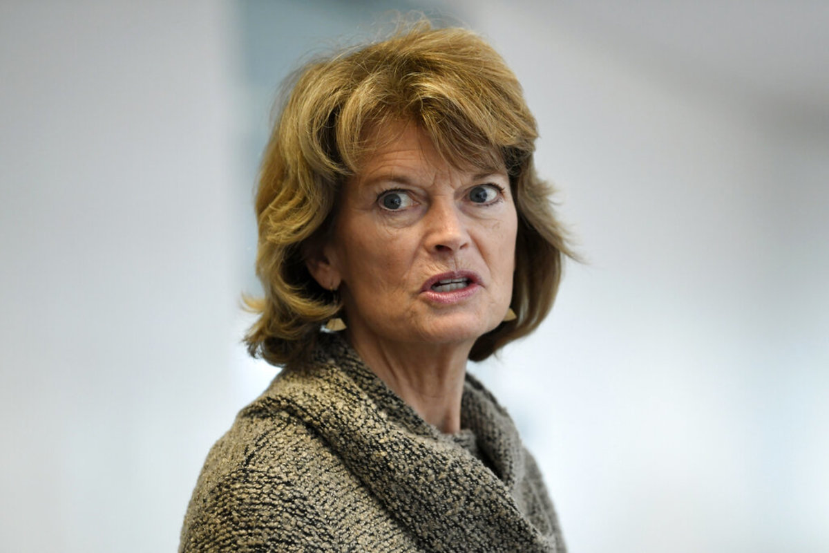 "In this March 19, 2020, file photo Sen. Lisa Murkowski, R-Alaska, talks with reporters following a Republican policy lunch on Capitol Hill in Washington. Murkowski acknowledged Thursday, June 4, that she's ""struggling"" over whether she can support President Donald Trump given his handling of the virus and race crises shaking the United States. (AP Photo/Susan Walsh, File)"