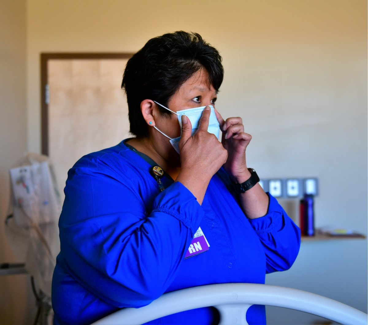 Eileen Russell, RN, is the Supervisory Clinical Nurse of the Emergency Department at Kayenta Health Center. She is demonstrating how to don a