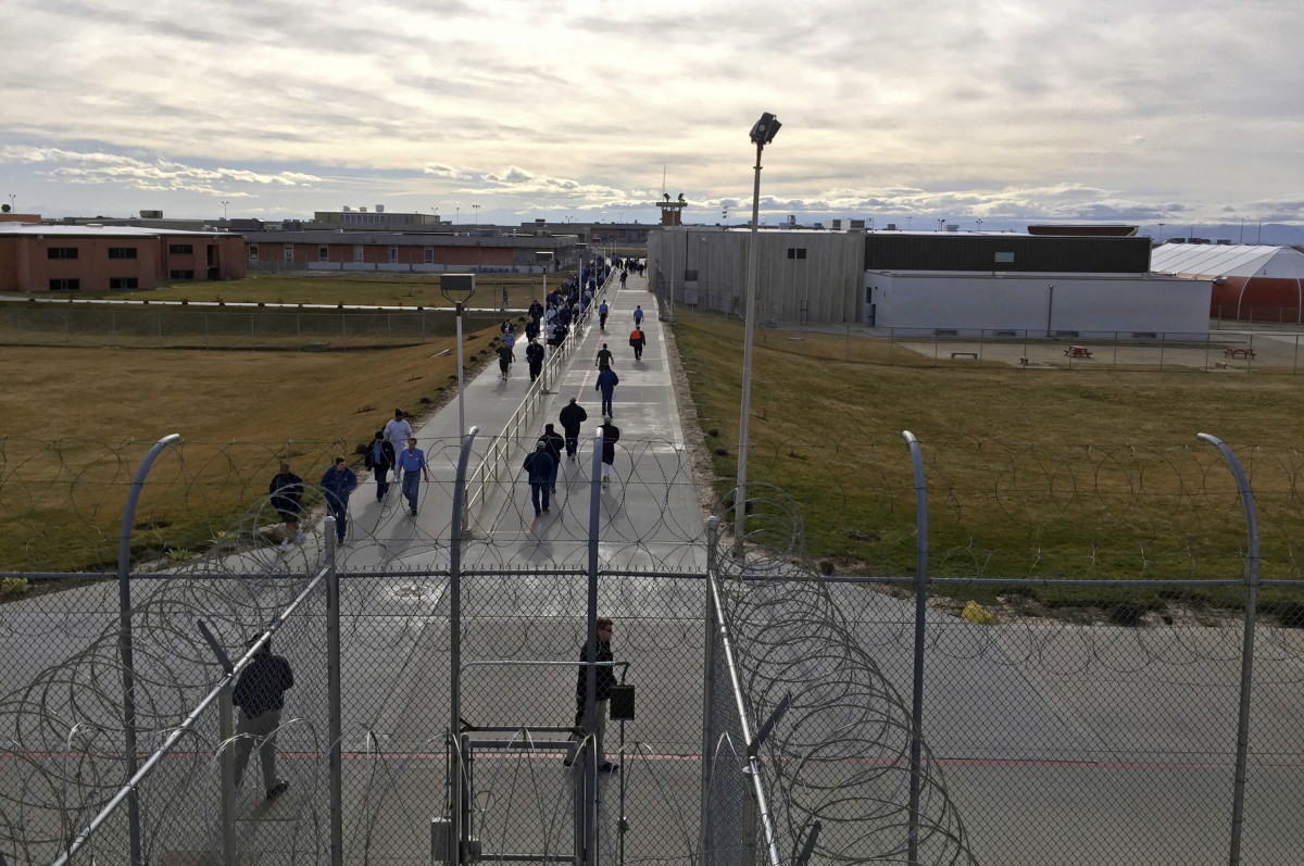 In this Jan. 30, 2018 file photo, inmates walk across the grounds of the Idaho State Correctional Institution in Kuna, Idaho. Idaho transgender inmate Adree Edmo has spent most of her prison term at this men's prison facility. A federal appellate court will hear arguments Thursday, May 16, 2019, in a lawsuit brought by Edmo who says the state is wrongly denying her gender confirmation surgery. (AP Photo/Rebecca Boone, File)