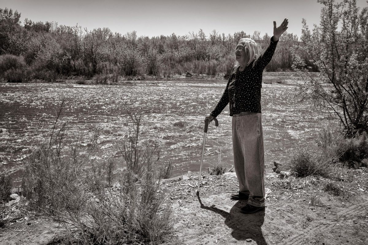 Gloria Emerson beside the San Juan River near her home in Shiprock. (Photo by Don J. Usner, Searchlight New Mexico)