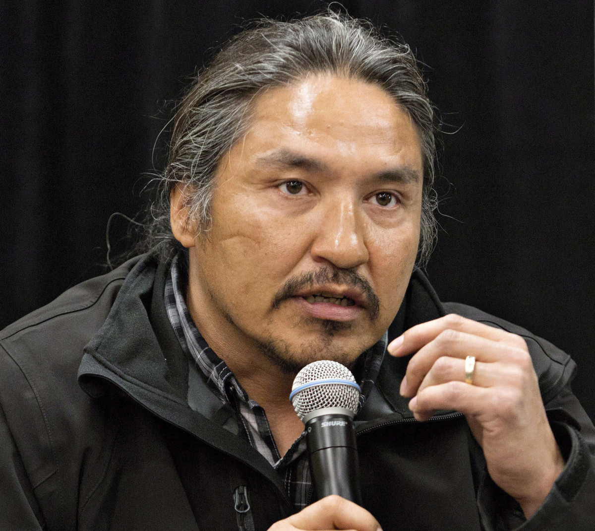 In this May 30, 2014 file photo, Chief Allan Adam of the Athabasca Chipewyan First Nation speaks during a news conference in Fort McMurray, Alberta, Canada. Canadian Prime Minister Justin Trudeau says police dashcam video of the violent arrest of Adam is shocking and not an isolated incident. The arrest has received attention in Canada as a backlash against racism grows in the wake of the death of George Floyd, a black man who died after a white Minneapolis police officer pressed a knee to his neck. (Jason Franson/The Canadian Press via AP)