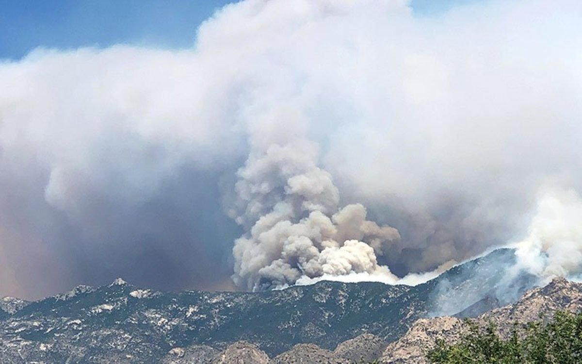 North of Tucson in the Santa Catalina Mountains, the Bighorn Fire remains a constant presence on the city's skyline. Air tankers continued to drop retardant near Mt.Lemmon and the Sky Center Observatory on Thursday. (Photo courtesy of Arizona State Forestry)